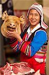 China, Yunnan, Xishuangbanna. A lady butcher of the Jinuo ethnic minority in a market near Jinghong.