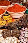 China, Yunnan, Jinghong. Spices and noodles for sale at Jinghong market.