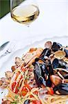 Italy, Campania, Salerno district, Peninsula of Sorrento, Positano. Valle dei mulini Restaurant. Spaghetti allo scoglio with molluscs and crustaceans.