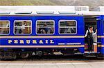 South America, Peru, Cusco, Sacred Valley, Ollantaytambo. The Vistadome train which runs between Machu Picchu and Cosco Poroy, at Ollantaytambo railway station.