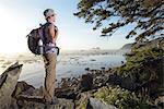 Woman hiker at Cape Alava, Olympic National Park, Clallam County, Washington, USA