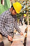 Carpenter preparing bevel cut for a rafter