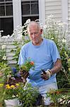 Senior man preparing to plant flowers in his garden