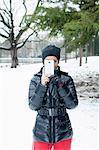 Woman taking picture in snowy field