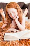 Girl reading on living room floor