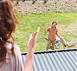 Woman arguing with boyfriend in backyard