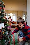 Boy examining Christmas presents