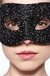 Woman wearing glitter mask over eyes