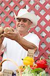 Man selling potatoes at farmer?s market
