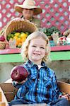 Boy holding apple at farmer's market