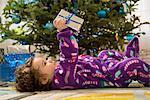 Toddler girl opening Christmas gifts