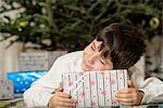 Boy hugging Christmas gift