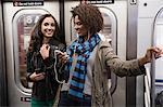 Women talking on subway