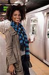 Woman having coffee at subway station