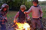 Boys building bonfire outdoors
