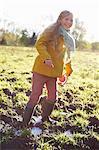 Girl wading in muddy field