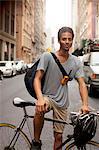 Man on bicycle on city street