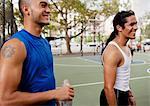 Men laughing on basketball court