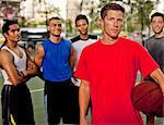 Men standing on basketball court