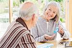 Caucasian couple organizing pills