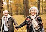 Older couple walking together in park