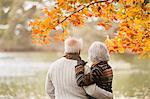 Older couple standing in park