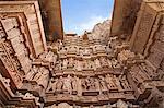 Low angle view of erotic carvings at a temple, Khajuraho, Chhatarpur District, Madhya Pradesh, India