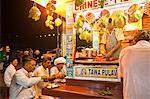 People eating food at a food stall, Juhu Beach, Mumbai, Maharashtra, India