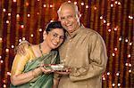 Couple holding pooja thali