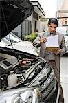 Insurance adjuster inspecting a car