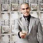 Businessman showing money