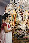 Woman holding a pooja thali at Durga puja festival