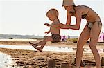 Croatia, Dalmatia, Mother And Son On Sandy Beach