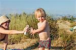 Croatia, Dalmatia, Mother And Son On Beach