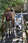 Croatia, Paklenica, Family with one child crossing bridge