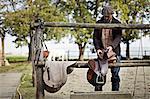 Man Preparing Riding Equipment, Baranja, Croatia, Europe