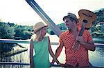 Croatia, Dalmatia, Young couple on a footbridge, man with guitar