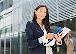 Businesswoman walking on city street