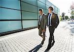 Businessmen walking on city street