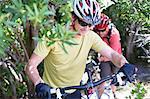 mountain bikers in rural landscape