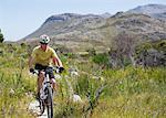 mountain biker on dirt path