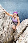 Climber scaling rock face