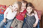 Three Girls On Sofa, Kottgeisering, Bavaria, Germany, Europe