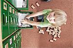 Little Boy Standing On Cupboard In Nursery School, Kottgeisering, Bavaria, Germany, Europe