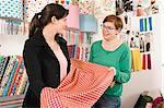 Women In A Shop Choosing Fabric, Munich, Bavaria, Germany, Europe