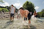 Teenage Boys Playing In River, Sonthofen, Schattwald, Bavaria, Germany