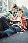 Two boys using digital tablet, Osijek, Croatia, Europe
