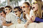 Children watching television wearing 3D glasses, Osijek, Croatia, Europe