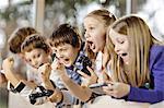 Children playing video game, Osijek, Croatia, Europe
