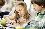 Children doing homework and using digital tablet, Osijek, Croatia, Europe